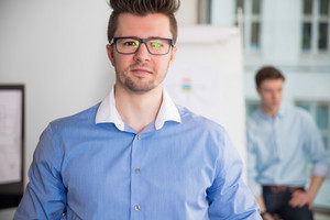 Confident Businessman Wearing Eyeglasses In Office