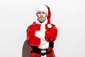 Confident man santa claus standing with arms crossed