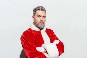 Confident man santa claus standing with hands folded