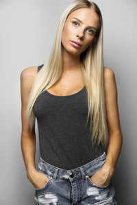 Confident Woman In Casuals Standing Over Gray Background