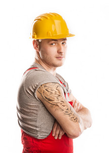 Construction worker in a protective helmet isolated over white background