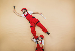 Construction workers have an accident. Funny studio poses.