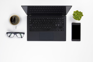Contemporary white office desk with Laptop and Coffee Cup