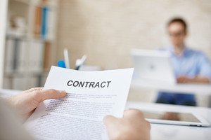 Contract in businessman hands in working environment
