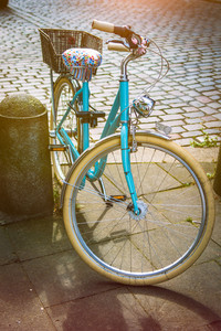 Cool vintage blue bycicle parked in central city hamburg