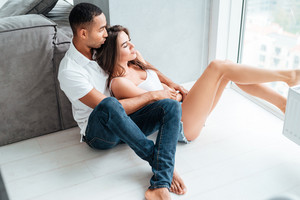 Couple near window. interracial couple. so good portrait