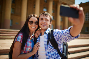 Couple of tourists making selfie against the beautiful building