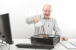 Crazy Businessman Pouring Coffee In Computer Chassis