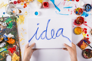 Creative idea concept with colorful paints over white paper