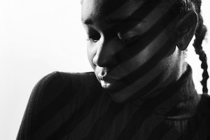 Creative stripes from projection light on beautiful woman with dark skin