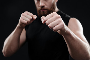 Cropped portrait of fighter. isolated dark background