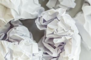Crumpled paper balls on an office desk