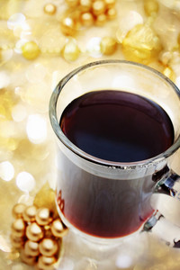 Cup of Coffee with Christmas Ornaments with Abstract Lights