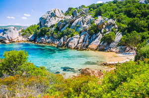 Cute bay surrounded by sand rocks near Porto Rafael, Palau, Sardinia, Italy