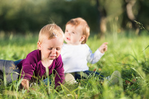 Cute little boy and girl outside in nature on a sunny day