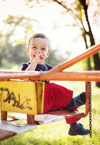 Cute little boy having fun on playground