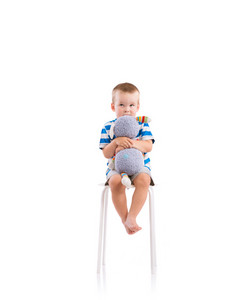 Cute little boy. Studio shot on white background.