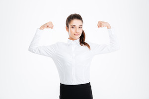 Cute lovely young businesswoman showing biceps