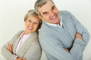 Cute senior family of two looking confidently at camera and smiling