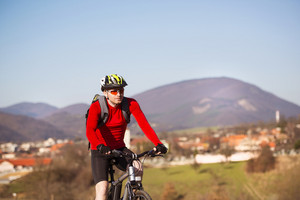 cyclist man riding mountain bike on outdoor trail in nature
