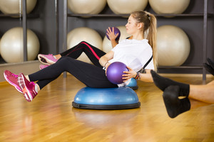 Dedicated woman trains abdominal exercise for core strength