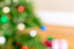 Defocused Christmas tree and gift boxes abstract background