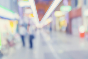 Defocused shopping mall interior with people browsing