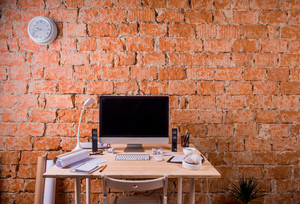 Desk with various gadgets and office supplies. Computer and stationery around the workplace. Copy space.
