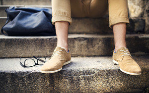 Detail of modern hipster man´s feet sitting on the stairs