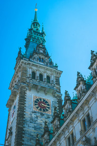 Detailed City Hall Tower with old clock. Hamburg, Germany. Vertical shot