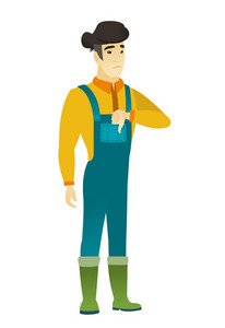 Disappointed asian farmer with thumb down. Full length of sad farmer in coveralls showing thumb down. Young farmer with his thumb down. Vector flat design illustration isolated on white background.