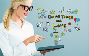 Do All Things With Love text with business woman using a tablet