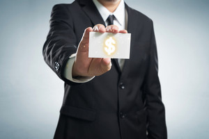 Dollar sign. Businessman in suit, shows business card.