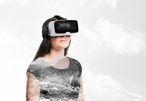 Double exposure. Beautiful woman wearing virtual reality goggles. Mountains. Nature