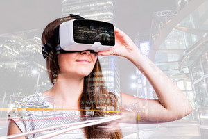 Double exposure. Beautiful woman wearing virtual reality goggles, smiling. City at night.