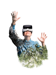 Double exposure. Beautiful woman wearing virtual reality goggles stretching arms. Trees, nature. Isolated.