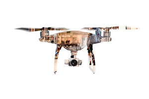 Double exposure. Close up of hovering drone taking pictures of big old warehouse. Isolated.