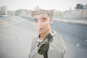 Double exposure half length portrait of young handsome caucasian brown straight hair woman, portrait and knee figure - creative, artistic, dreamy concept