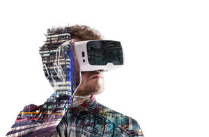 Double exposure. Hipster man in denim shirt wearing virtual reality goggles. City at night. London, England. Isolated.