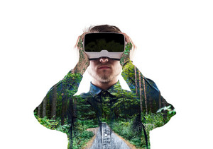 Double exposure. Hipster man in denim shirt wearing virtual reality goggles. Green forest, trees and road. Isolated.