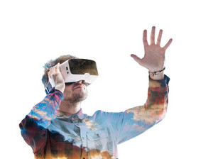 Double exposure. Hipster man in denim shirt wearing virtual reality goggles. Sky with clouds on sunset. Isolated.