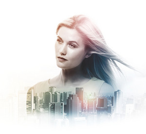 Double exposure of beautiful young woman and skyscrapers