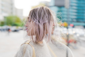 Double exposure of young beautiful caucasian purple grey hair woman outdoor in the city - creative, artistic concept