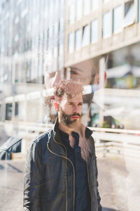Double exposure of young caucasian bearde man outdoor overlooking pensive - creative, pensive, serious concept