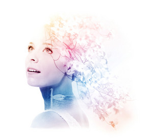 Double exposure of young woman with swan and dogwood flowers