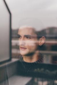 double exposure portrait handsome young man indoor looking away - artistic, creative, serious concept