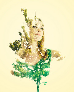 Double exposure portrait of young woman with abstract leaves