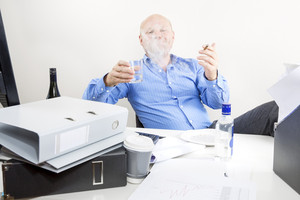 Drunk businessman smokes and drink at office