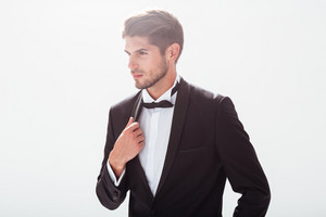 Elegant man in suit. looking away