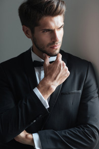 Elegant model in suit. looking away
